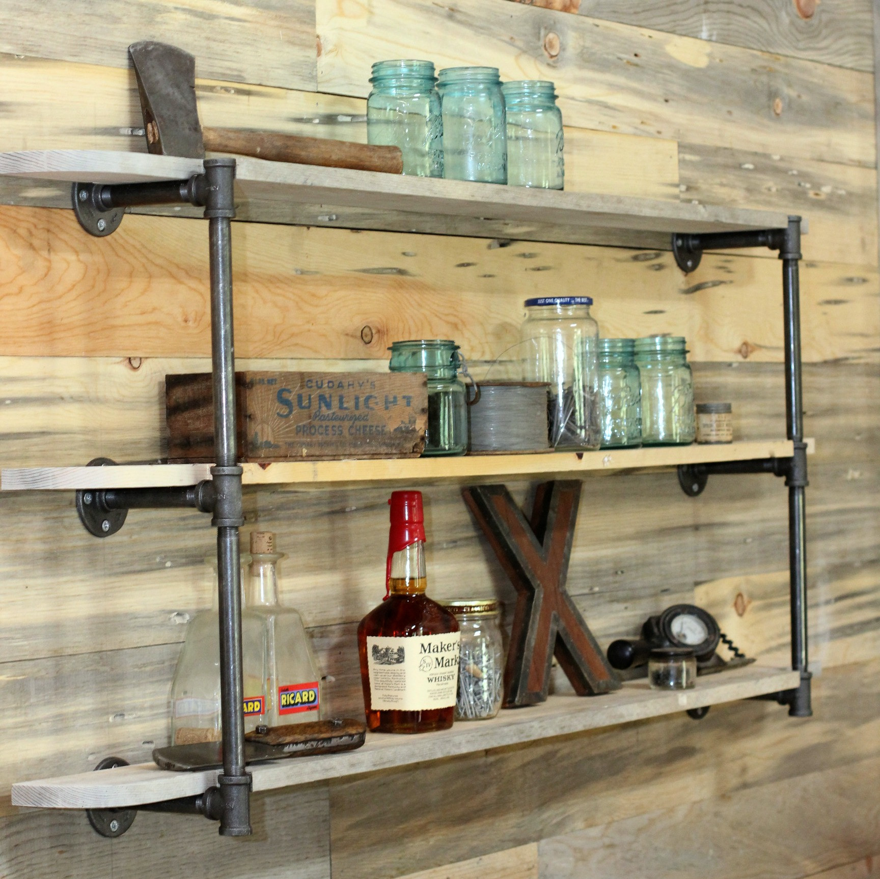 DIY Pipe And Wood Shelves  DIY Pipe Shelf & Reclaimed Wood Plank Walls