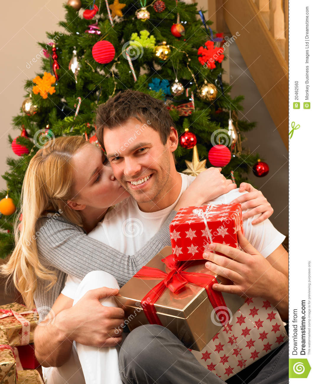 Gift Ideas For Young Couple  Young Couple With Gifts In Front Christmas Tree Stock