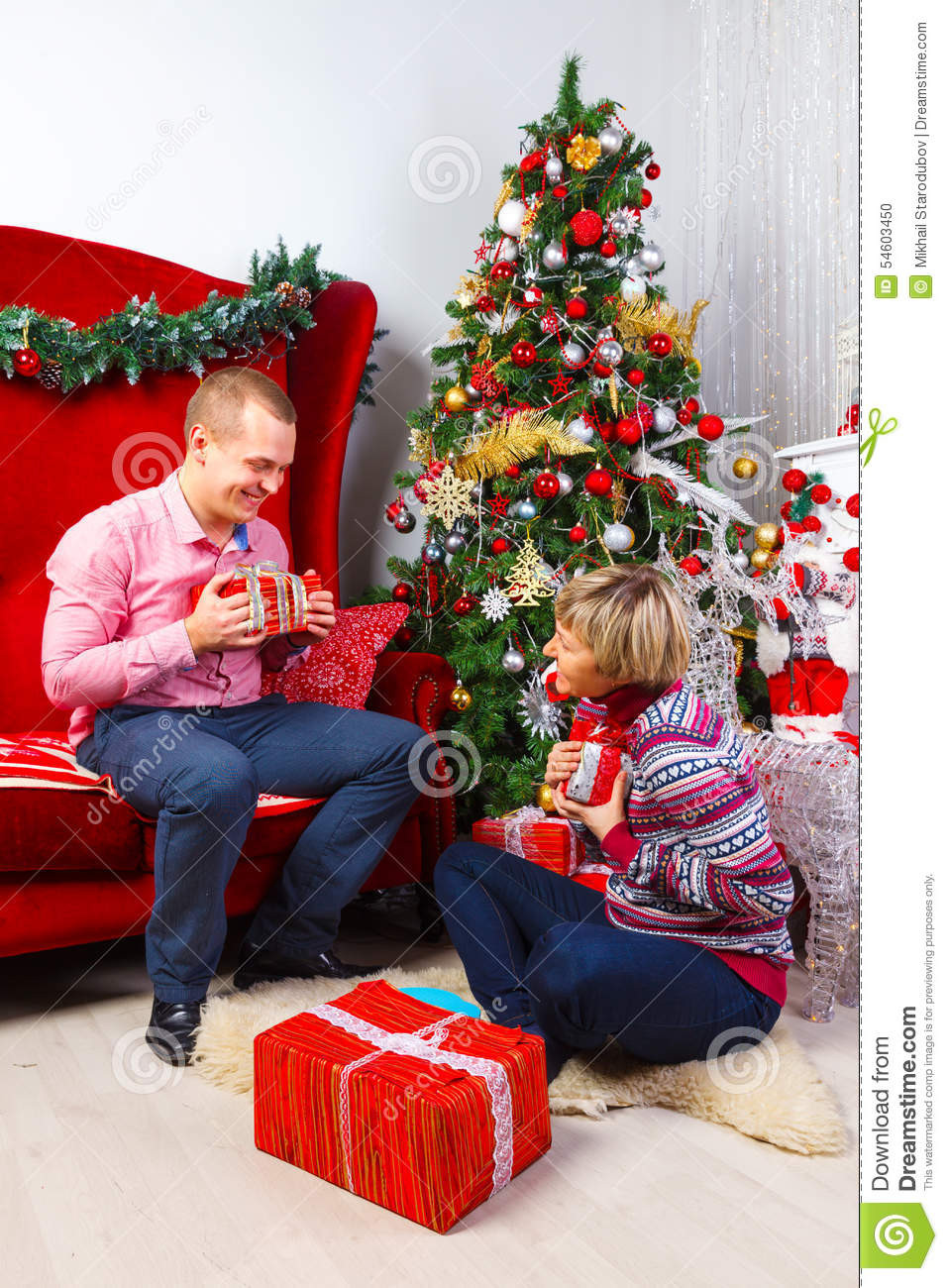 Gift Ideas For Young Couple  Happy Young Couple With Gifts At New Year Stock