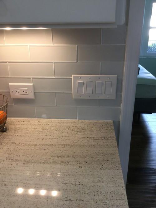 Kitchen Backsplash Outlets  Outlet cover plates on glass tile backsplash
